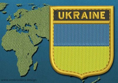 This Flag of Ukraine Shield with a Gold border design was digitized and embroidered by www.embroidery.design.