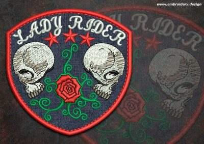 This Biker patch Two Skulls with a rose round design was digitized and embroidered by www.embroidery.design.