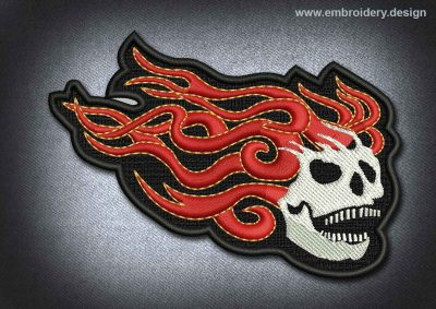 This Skull Patch Skull With Fiery Hair design was digitized and embroidered by www.embroidery.design.